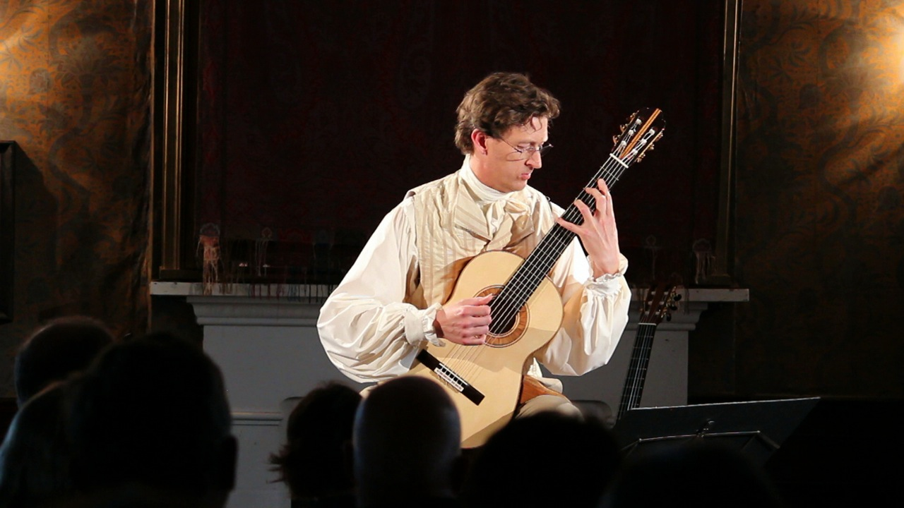 Bruce Paine classical guitarist in performance